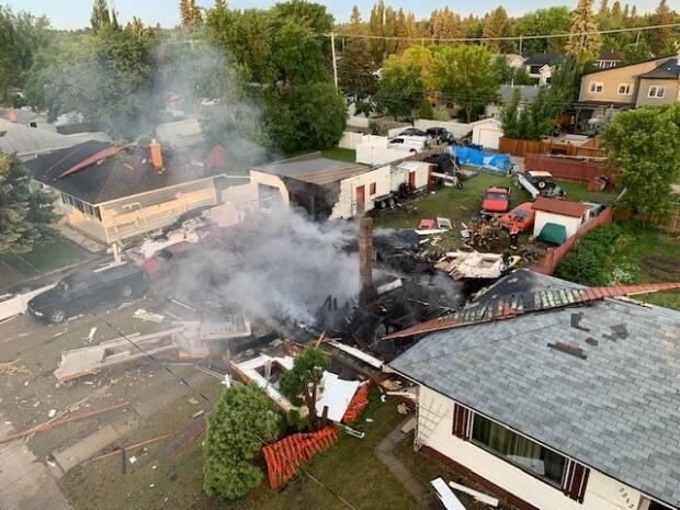 The cause of the explosion and the extent of damage to neighbouring homes are still under investigation, the Saskatoon Fire Department says. (Submitted by Saskatoon Fire Department - image credit)