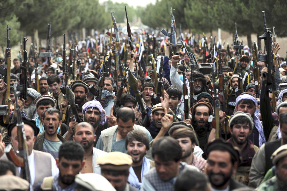 Afghan militiamen join Afghan defense and security forces during a gathering in Kabul, Afghanistan, Wednesday, June 23, 2021. (AP Photo/Rahmat Gul)