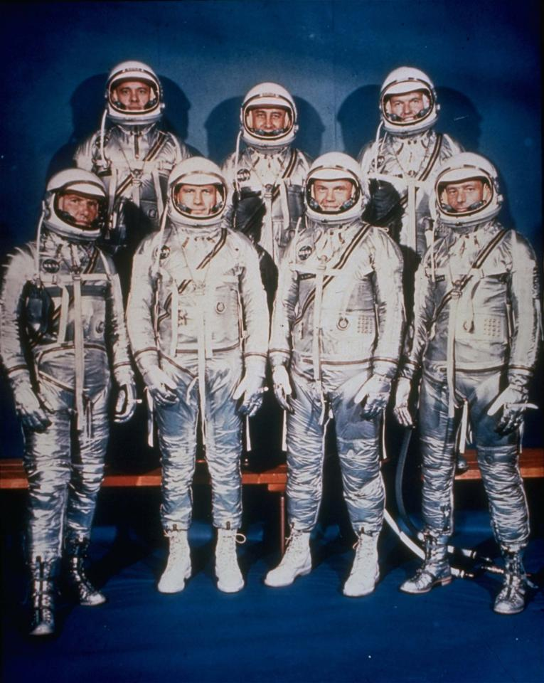 FILE - This 1961 file photo provided by NASA shows the original seven Mercury astronauts in their silver spacesuits. From left, first row are Walter Schirra Jr., Donald Slayton, John Glenn and Scott Carpenter. In the back row are Alan Shepard, Jr., Virgil Grissom and Gordon Cooper. NASA's mighty astronaut corps has become a shadow of what it once was. And it's only going to get smaller. It's down to 60 from an all-time high of 149 just a decade ago, with more departures coming once Atlantis returns this week from the very last space shuttle voyage. (AP Photo/NASA, File)