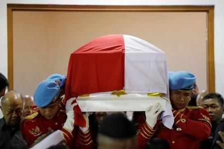 Presidential guards carry the casket of former Indonesian President B.J. Habibie, who passed away this afternoon, at Gatot Soebroto Army hospital in Jakarta