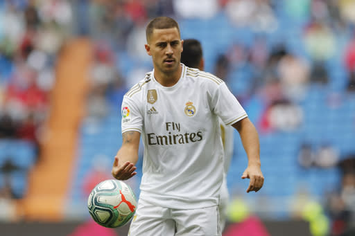 Real Madrid's Eden Hazard holds the ball during the Spanish La Liga soccer match between Real Madrid and Levante at the Santiago Bernabeu stadium in Madrid, Spain, Saturday, Sept. 14, 2019. (AP Photo/Bernat Armangue)