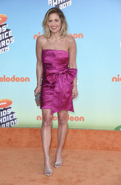 "This photo taken Saturday, March 23, 2019, shows Candace Cameron-Bure arriving at the Nickelodeon Kids' Choice Awards in Los Angeles. Bure says ""family sticks together no matter what,"" in what seems a sign of support for ""Fuller House"" co-star Lori Loughlin, who has been charged in an alleged college admissions scandal. Bure delivered that message in her acceptance speech Saturday night at the Nickelodeon Kids' Choice Award for Favorite Funny TV Show. She later shared those thoughts on Instagram. (Photo by Richard Shotwell/Invision/AP)"