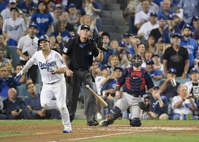 Los Angeles Dodgers' Joc Pederson watches his home run against the Boston Red Sox during the third inning in Game 3 of the World Series baseball game on Friday, Oct. 26, 2018, in Los Angeles. (AP)