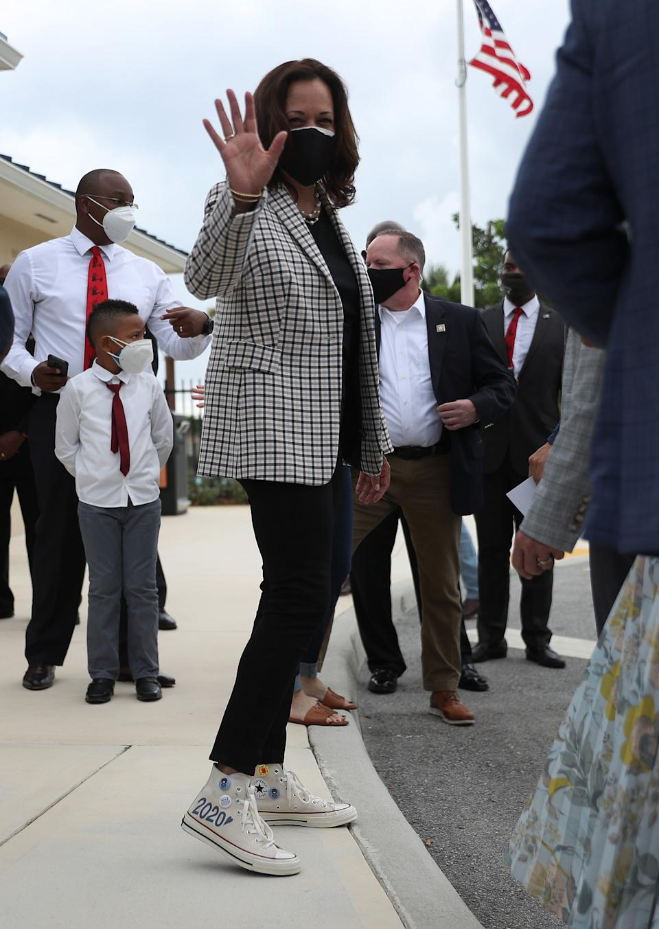 MIAMI GARDENS, FLORIDA - OCTOBER 31: Democratic Vice Presidential Nominee Sen. Kamala Harris (D-CA) waves after speaking to the media during a stop at Buccaneer Park on October 31, 2020 in Miami Gardens, Florida. Harris continues to campaign before the November 3rd election day. (Photo by Joe Raedle/Getty Images)