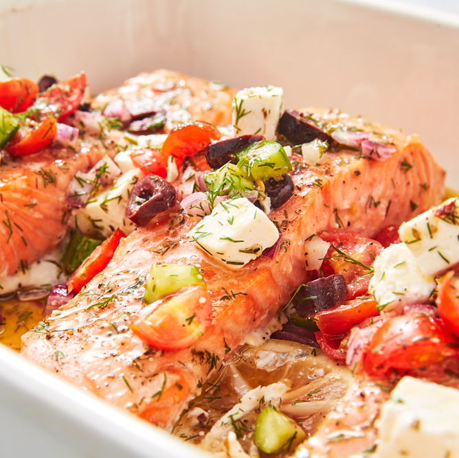 """<p>We love this meal because it comes with lots of veggies! If you want to be extra-healthy, serve the salmon over a bed of rocket or spinach.</p><p>Get the <a href=""""https://www.delish.com/uk/cooking/recipes/a29205150/greek-salmon-recipe/"""" rel=""""nofollow noopener"""" target=""""_blank"""" data-ylk=""""slk:Greek Salmon"""" class=""""link rapid-noclick-resp"""">Greek Salmon</a> recipe. </p>"""
