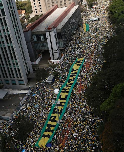 """The depth of anger against President Dilma Rousseff was undeniable on August 16, 2015, when almost a million people poured into the streets across Brazil chanting """"Dilma out!"""" (AFP Photo/Miguel Schincariol)"""