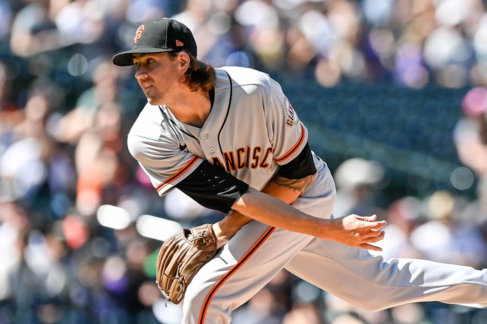 DENVER, CO - SEPTEMBER 26: Kevin Gausman #34 of the San Francisco Giants pitches against the Colorado Rockies in the first inning of a game at Coors Field on September 26, 2021 in Denver, Colorado. (Photo by Dustin Bradford/Getty Images)