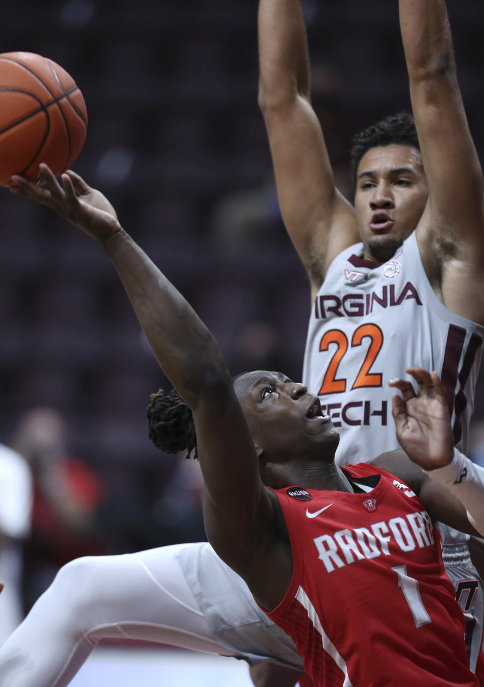 Radford's Keishon Porter (1) attempts to shoot past Virginia Tech's Keve Aluma (22) during the second half of an NCAA college basketball game, Wednesday Nov. 25, 2020, in Blacksburg Va. (Matt Gentry/The Roanoke Times via AP)