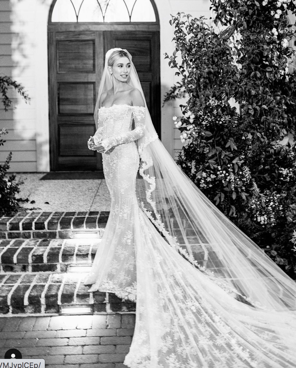 """<p>In the fall of 2019, Hailey Baldwin married Justin Bieber wearing a custom design by Virgil Abloh for Off-White. The words """"wedding dress"""" were stitched into the back of the gown in pearls, and """"TILL DEATH DO US PART"""" was embroidered into the hem of the veil.</p>"""