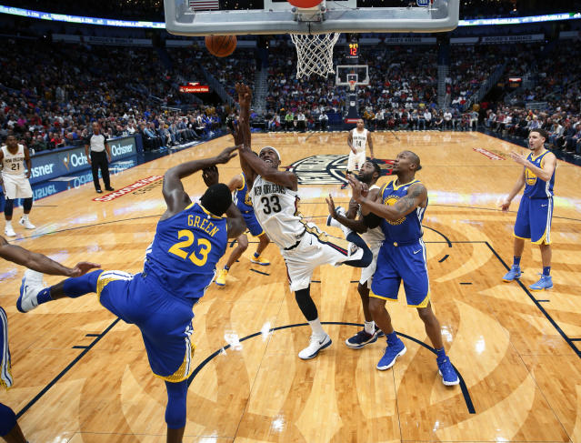 New Orleans Pelicans forward Dante Cunningham (33) goes to the basket against Golden State Warriors forward Draymond Green (23) in the first half of an NBA basketball game in New Orleans, Monday, Dec. 4, 2017. (AP Photo/Gerald Herbert)