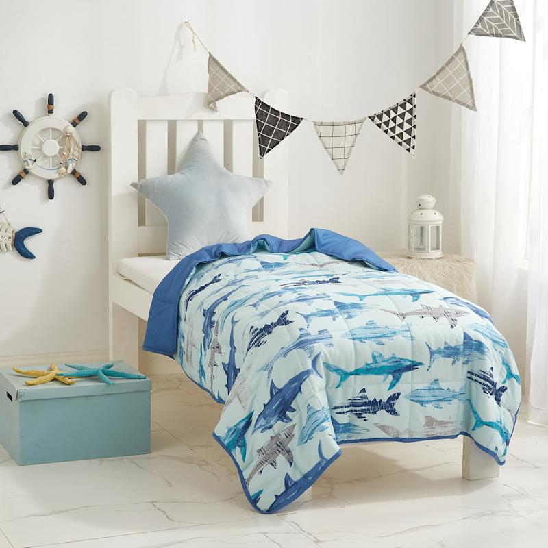 Take a bite out of sleep issues with this shark-themed blanket. (Photo: Walmart)