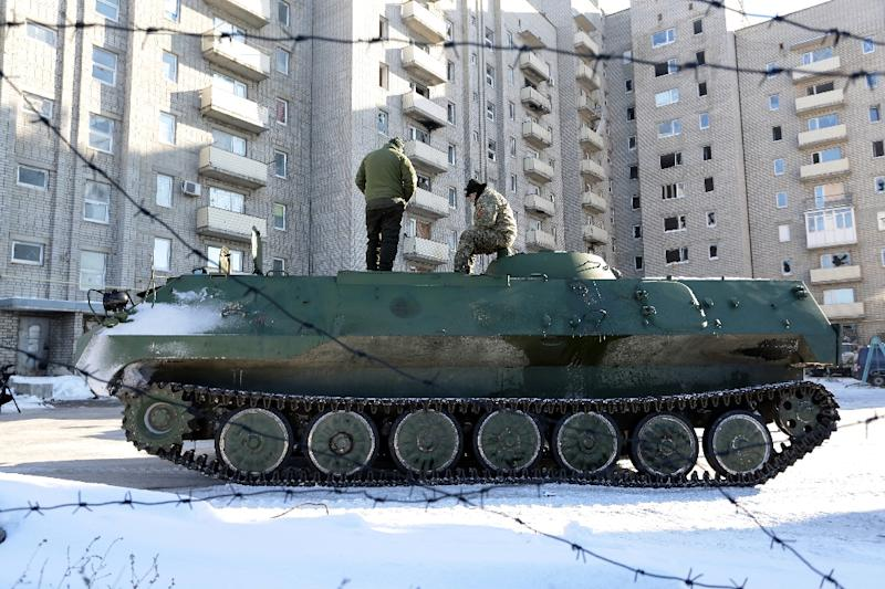 Ukrainian medical servicemen stand on an Armoured Personnel Carriers (APC) after they carried wounded servicemen to hospital in Ukraine-controlled town of Avdiivka, in Donetsk region on January 30, 2017