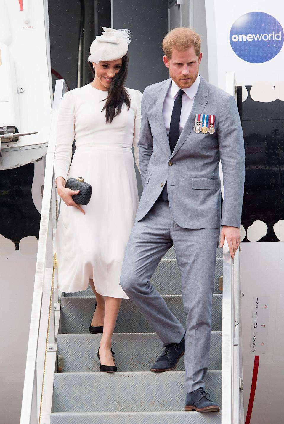 <p>The Duchess of Sussex touched down at Nausori Airport on October 23 in a bespoke cream-hued dress by Aussie label Zimmerman with a co-ordinating hat by Stephen Jones. But it was her jewellery that hit headlines: The Duchess paired earrings from the Queen with a bracelet from Prince Charles. <em>[Photo: Getty]</em> </p>