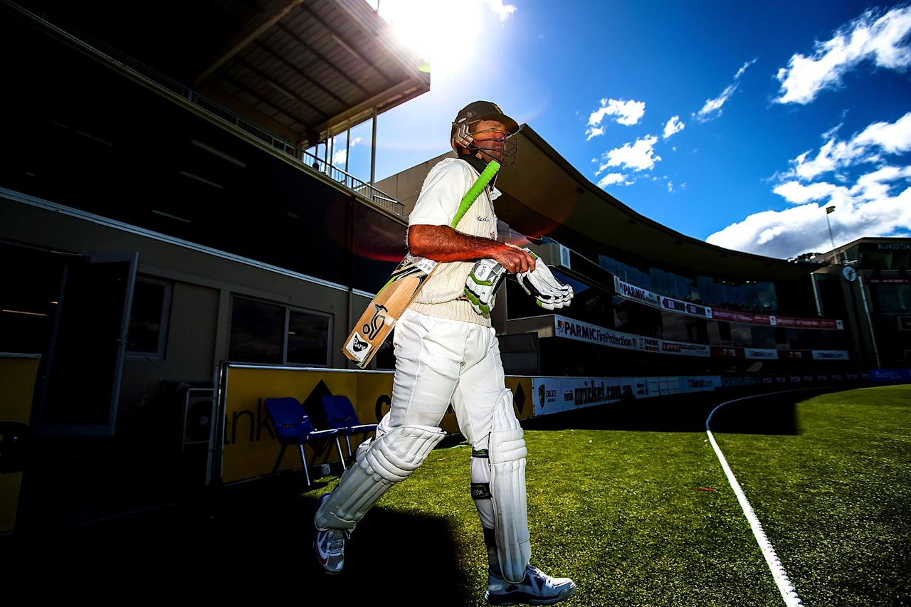 HOBART, AUSTRALIA - MARCH 14: Ricky Ponting of Tasmania walks out to bat during day one of the Sheffield Shield match between the Tasmanian Tigers and the Victorian Bushrangers at Blundstone Arena on March 14, 2013 in Hobart, Australia.  (Photo by Mark Nolan/Getty Images)