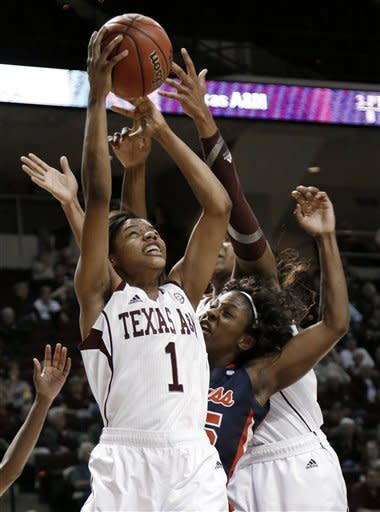 Mississippi's Courtney Marbra, center, is sandwiched between Texas A&M's Courtney Williams (1) and Kelsey Bone during the first half of an NCAA college basketball game Thursday, Feb. 21, 2013, in College Station, Texas. (AP Photo/Pat Sullivan)