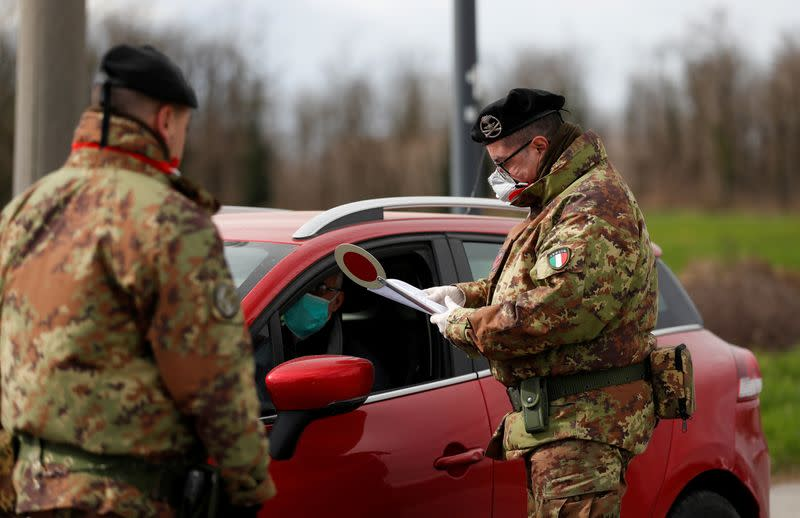FILE PHOTO: Members of the Italian army guard the entrance of the red zone of Turano Lodigiano