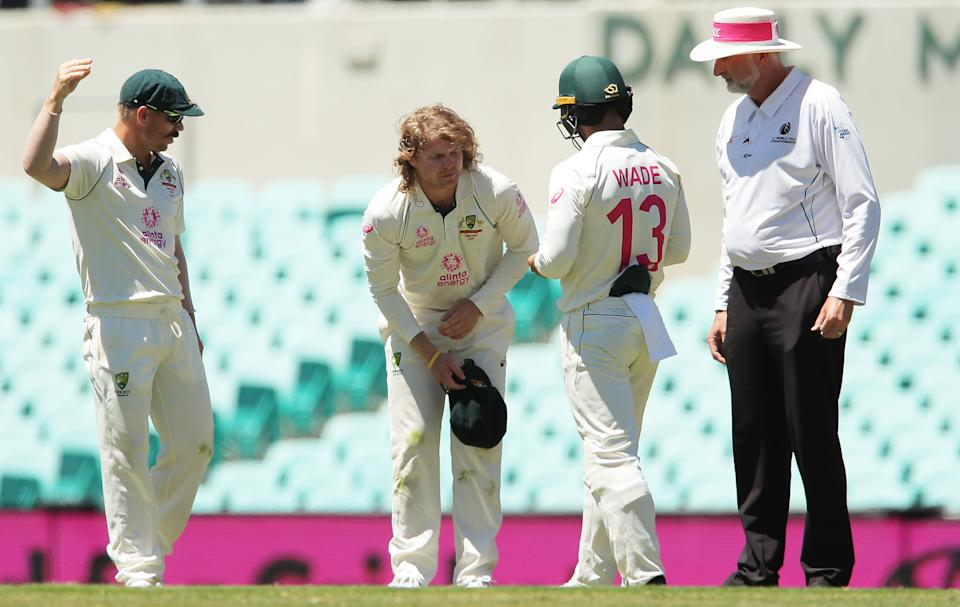 Pictured here, Will Pucovski of Australia shows discomfort after injuring his shoulder during day five of the Test match in the series between Australia and India in 2021.