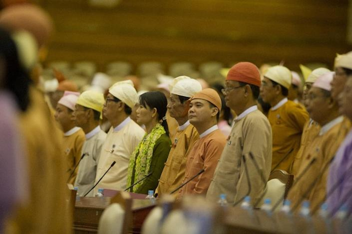 Myanmar lawmakers belonging to Aung San Suu Kyi's National League for Democracy attend a parliamentary meeting in Naypyidaw, on March 10, 2016 (AFP Photo/Ye Aung Thu)