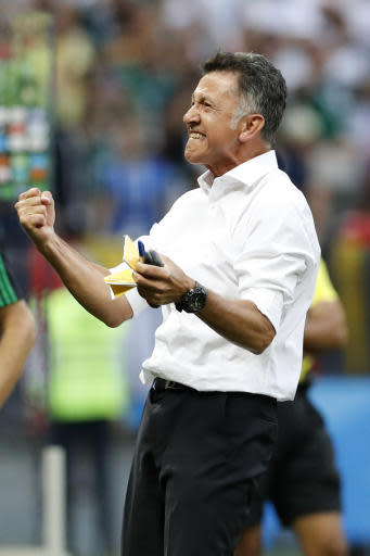 Mexico head coach Juan Carlos Osorio celebrates after winning the group F match between Germany and Mexico at the 2018 soccer World Cup in the Luzhniki Stadium in Moscow, Russia, Sunday, June 17, 2018. Mexico won Germany 1-0. (AP Photo/Antonio Calanni)