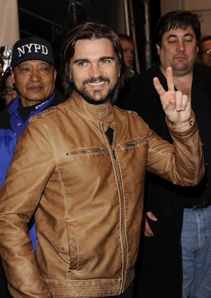 Colombian singer Juanes arrives to see Bruce Springsteen and the E Street Band perform at the Apollo Theater on Friday, March 9, 2012 in New York. The concert was hosted by SiriusXM in celebration of 10 years of satellite radio. (AP Photo/Evan Agostini)