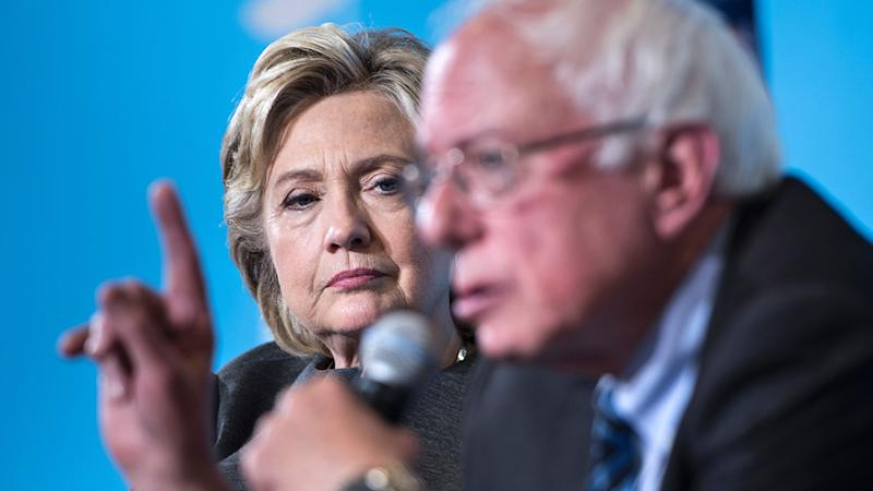 Democratic presidential nominee Hillary Clinton listens as Senator Bernie Sanders (I-VT) speaks during an event at University of New Hampshire September 28, 2016 in Durham, New Hampshire. (Photo: Brendan Smialowski/AFP via Getty Images)