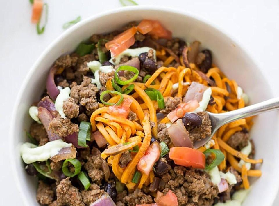 """Whip up a healthy, protein-packed dinner for your family in no time! People talk a lot of smack about red meat, but the truth is it can be part of a healthy diet. Aside from delivering amino acids that increase satiety, <a rel=""""nofollow noopener"""" href=""""https://www.eatthis.com/best-ways-to-speed-up-your-metabolism?utm_source=yahoo-news&utm_medium=feed&utm_campaign=yahoo-feed"""" target=""""_blank"""" data-ylk=""""slk:speed up metabolism"""" class=""""link rapid-noclick-resp"""">speed up metabolism</a> and build lean muscle, beef contains healthy doses of iron, zinc, niacin, selenium, vitamin E and B vitamins — nutrients that support blood formation, as well as brain and nervous system function. Here's how to eat it: Limit weekly consumption to roughly 3 ounces. Consuming fat in excess, healthy or not, results in one thing: flab. Ground beef is sold with 5 to 30 percent fat, giving you the option to choose from 80-95 percent lean varieties. However, the leaner the cut, the lower the vitamin and mineral content. We recommend going for 90 percent lean, which yields 182 calories, 9 grams of fat and up to 24 grams of protein per 3-ounce serving. Finally, always go for <a rel=""""nofollow noopener"""" href=""""https://www.eatthis.com/cost-of-grass-fed-beef/?utm_source=yahoo-news&utm_medium=feed&utm_campaign=yahoo-feed"""" target=""""_blank"""" data-ylk=""""slk:grass-fed"""" class=""""link rapid-noclick-resp"""">grass-fed</a>. It's naturally lower in calories and fat than grain-fed beef. Additionally, it contains more heart-healthy omega-3s, less saturated fat, and as much as four times the vitamin E. We've compiled a list of ground beef recipes that are pretty epic. From breakfast to dinner, we've even included healthified dietary sinners. Pick one a week to enjoy without guilt."""