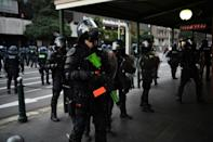 At least three police officers sustained injuries in the protests (AFP/William WEST)