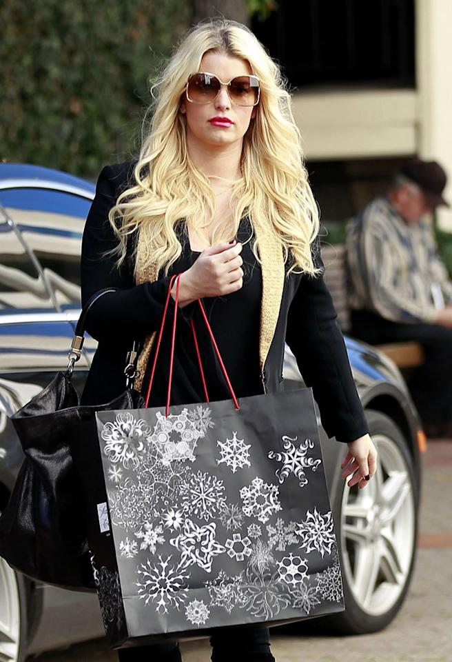 Jessica Simpson is one strategic holiday shopper: The rumored mom-to-be made sure to hold her shopping bags in front of her belly as she dashed in and out of stores in Beverly Hills.