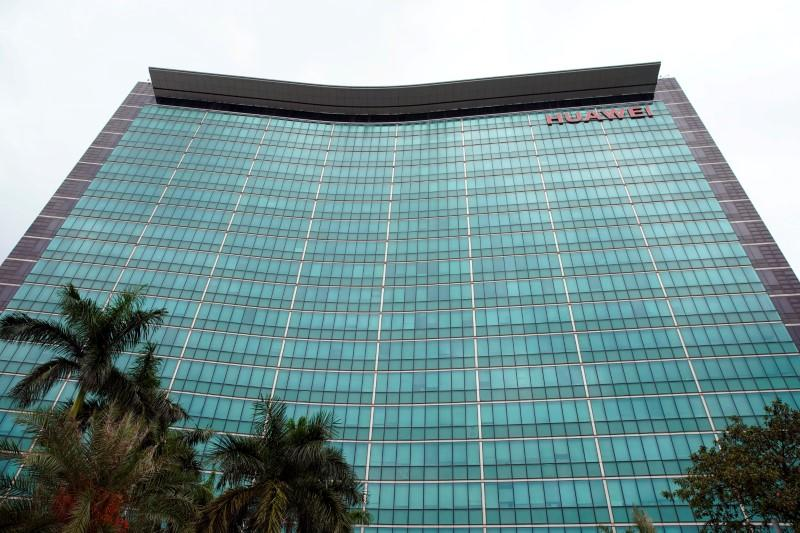 FILE PHOTO: A Huawei company logo is seen at the company headquarters in Shenzhen