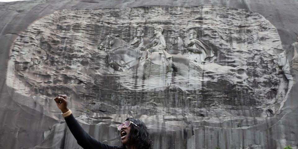 A woman speaks in front of the Stone Mountain Confederate Memorial in Stone Mountain, Georgia, at a separate protest on June 16, 2020.