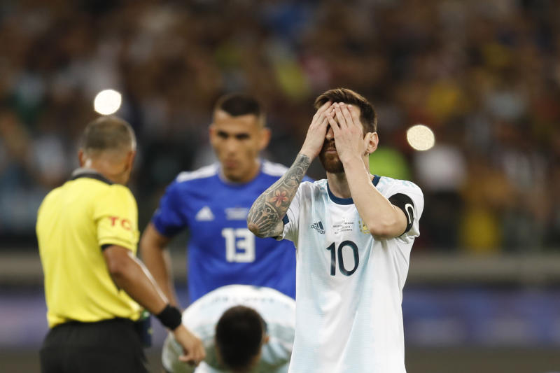 Argentina's Lionel Messi touches his face before scoring from a penalty spot against Paraguay during a Copa America Group B soccer match at the Mineirao stadium in Belo Horizonte, Brazil, Wednesday, June 19, 2019. (AP Photo/Natacha Pisarenko)