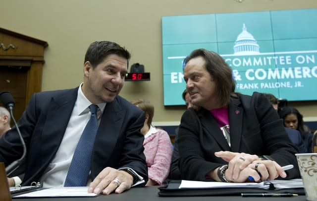 Sprint executive chairman Marcelo Claure, left, swith T-Mobile US chief executive and president John Legere