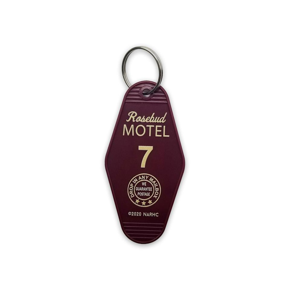 """<p><strong>Schitt's Creek Shop</strong></p><p>schittscreek.shop</p><p><strong>$8.00</strong></p><p><a href=""""https://schittscreek.shop/product/keychain"""" rel=""""nofollow noopener"""" target=""""_blank"""" data-ylk=""""slk:Shop Now"""" class=""""link rapid-noclick-resp"""">Shop Now</a></p><p>The official Schitt's Creek shop has <em>tons</em> of fun gift ideas, but I've picked out a few faves. First is this keychain, simple and classy, that'll make you feel like you're checking into the Rosebud Motel every time you get home. </p>"""