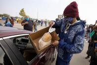 Rapper Snoop Dog helps at Thanksgiving Turkey Giveaway in Inglewood, California