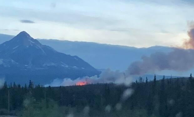 A wildfire in Yukon's Haines Junction area in 2019. The area is one of five listed as being at an extreme risk for fire this weekend.  (Submitted by Colleen Maloney - image credit)