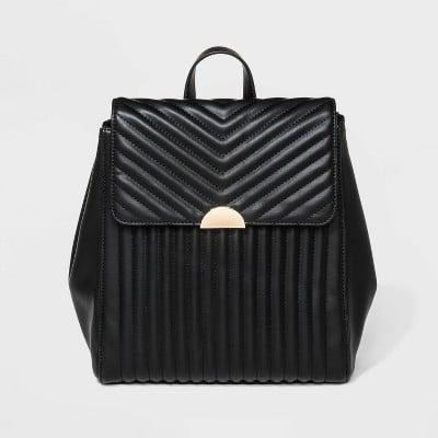 <p>Moira's had several fabulous bags throughout the show and this <span>Quilted Backpack</span> ($37) embodies her favorite pattern: stripes.</p>