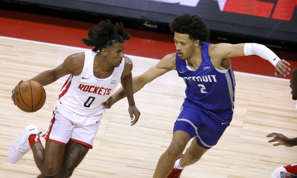 Houston's Jalen Green drives against Detroit's Cade Cunningham during a matchup of the top two draft picks at the 2021 NBA Summer League at the Thomas & Mack Center in Las Vegas on Aug. 10, 2021. (Ethan Miller/Getty Images)