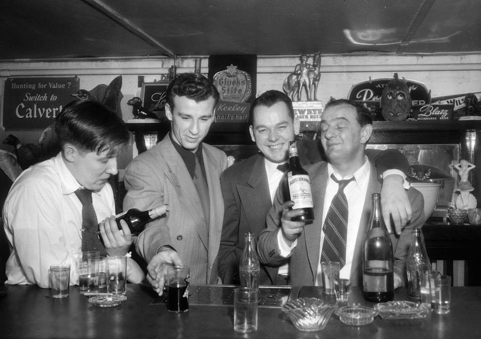 <p>Men are toasting and drinking in a Chicago bar in the 1940s. Chicago's retro bar and lounge scene has been frequented by blues legends and notorious clientele, alike. </p>