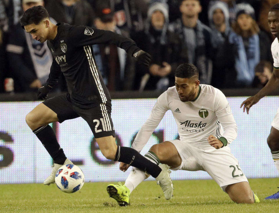 Sporting Kansas City midfielder Felipe Gutierrez (21) breaks past Portland Timbers' Bill Tuiloma during the first half in the second leg of the MLS soccer Western Conference championship in Kansas City, Kan., Thursday, Nov. 29, 2018. (AP Photo/Orlin Wagner)