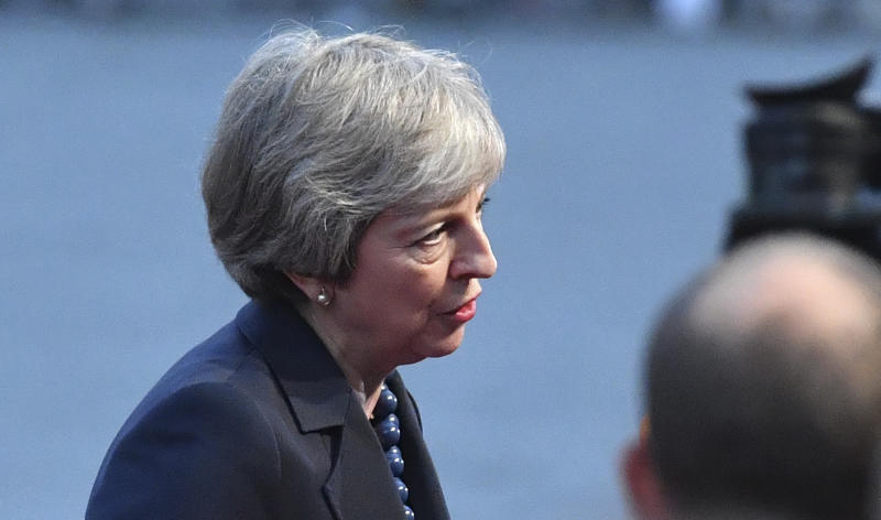 British Prime Minister Theresa May answers questions when arriving at the informal EU summit in Salzburg, Austria, Wednesday, Sept. 19, 2018. (AP Photo/Kerstin Joensson)