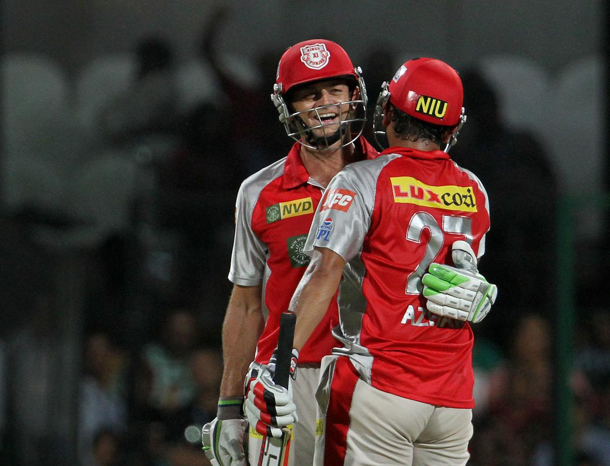 Kings XI Punjab player Azhar Mahmood congratulates Kings XI Punjab captain Adam Gilchrist on scoring a fifty during match 63 of the Pepsi Indian Premier League between The Royal Challengers Bangalore and The Kings XI Punjab held at the M. Chinnaswamy Stadium, Bengaluru  on the 14th May 2013..Photo by Vipin Pawar-IPL-SPORTZPICS    ..Use of this image is subject to the terms and conditions as outlined by the BCCI. These terms can be found by following this link:..https://ec.yimg.com/ec?url=http%3a%2f%2fwww.sportzpics.co.za%2fimage%2fI0000SoRagM2cIEc&t=1503256762&sig=aGTKvLkFpog9RSAyvG3VMg--~D