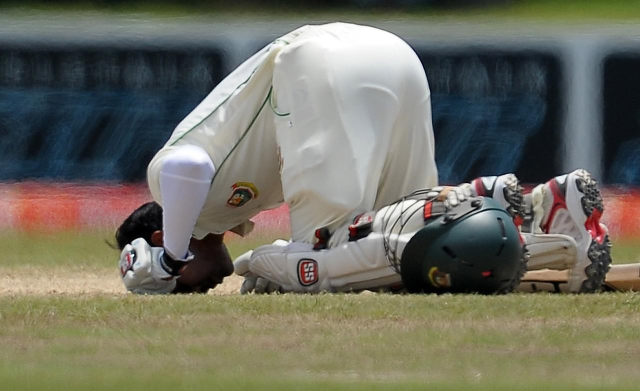 Bangladeshi captain Mushfiqur Rahim touches the ground after scoring a double century (200 runs) during the fourth day of the opening Test match between Sri Lanka and Bangladesh at the Galle International Cricket Stadium in Galle on March 11, 2013. AFP PHOTO/ LAKRUWAN WANNIARACHCHI        (Photo credit should read LAKRUWAN WANNIARACHCHI/AFP/Getty Images)