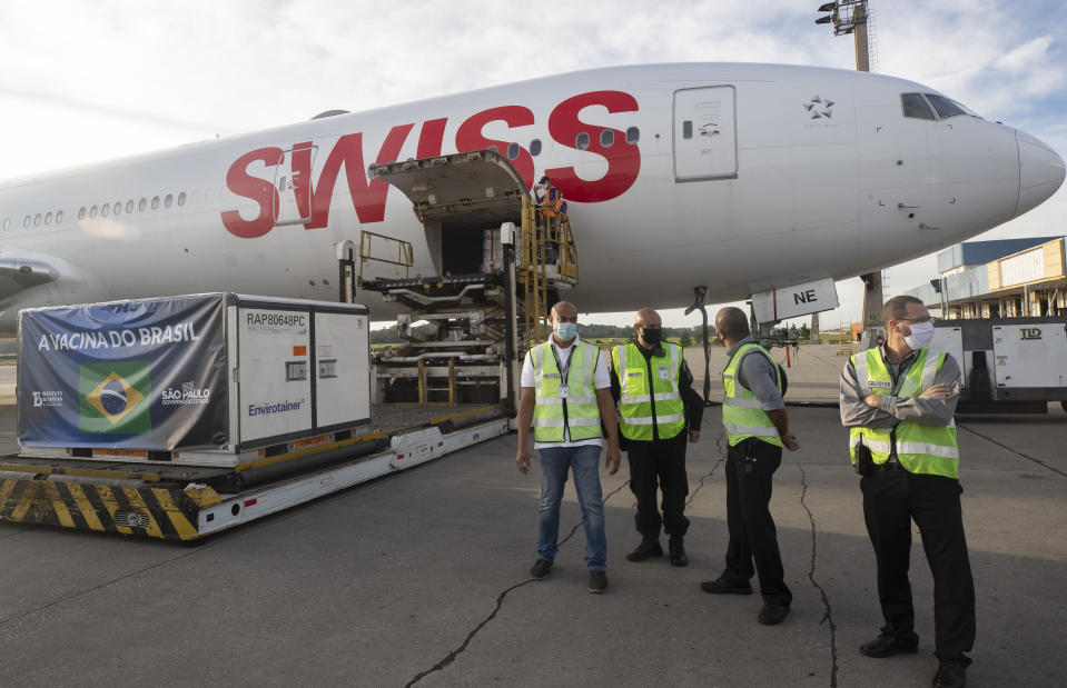 A container carrying the experimental COVID-19 vaccine CoronaVac is unloaded from a cargo plane that arrived from China at Guarulhos International Airport in Guarulhos, near Sao Paulo, Brazil, Thursday, Dec. 3, 2020. (AP Photo/Andre Penner)
