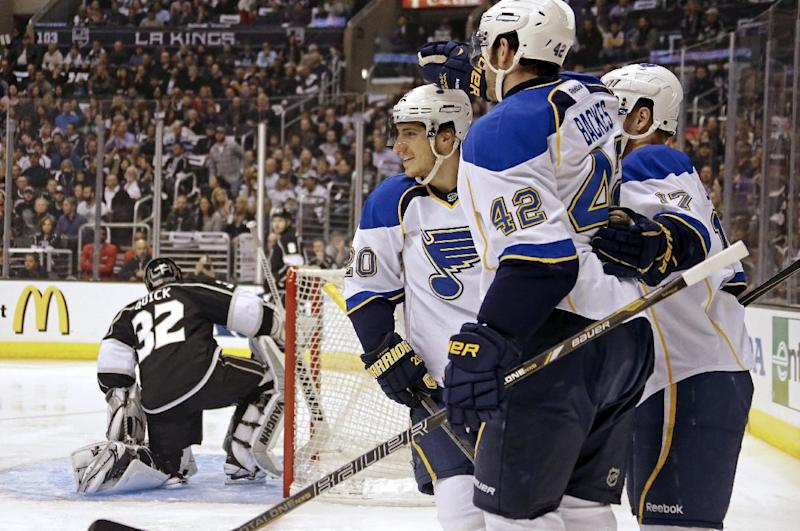St. Louis Blues center David Backes (42) and teammates celebrate their goal against Los Angeles Kings goalie Jonathan Quick (32) in the first period of Game 4 in the NHL Western Conference Stanley Cup hockey playoff series in Los Angeles, Monday, May 6, 2013. (AP Photo/Reed Saxon)