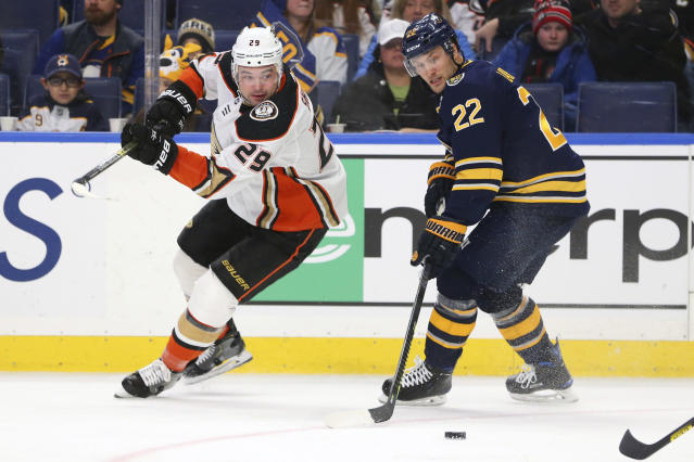 Buffalo Sabres forward Johan Larsson (22) and Anaheim Ducks forward Devin Shore (29) chase the puck during the first period of an NHL hockey game Sunday, Feb. 9, 2020, in Buffalo, N.Y. (AP Photo/Jeffrey T. Barnes)