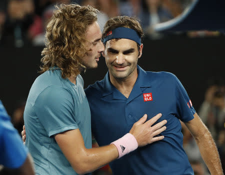 Tennis - Australian Open - Fourth Round - Melbourne Park, Melbourne, Australia, January 20, 2019. Switzerland's Roger Federer and Greece's Stefanos Tsitsipas greet each other after the match. REUTERS/Aly Song