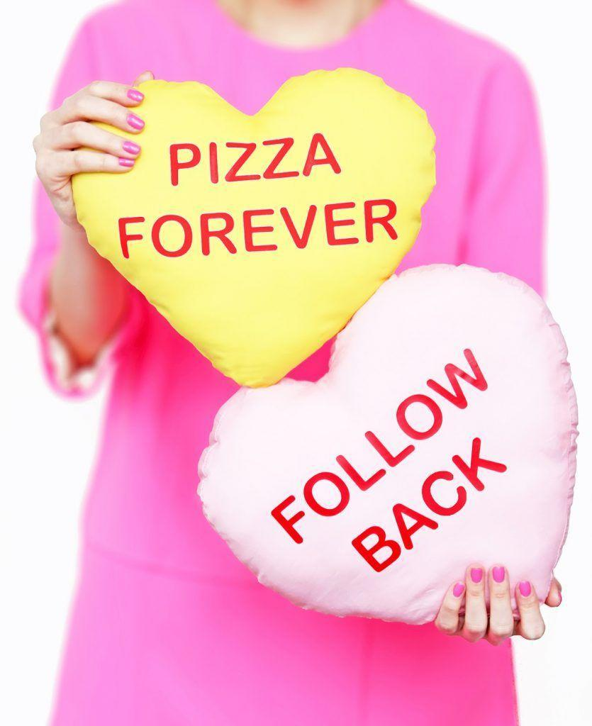 "<p>You don't need much sewing skill to whip up a batch of these candy heart pillows. Customize them with cheeky messages like ""Follow Back,"" ""Pizza Forever"" — or anything your heart desires.</p><p><em><a href=""http://www.awwsam.com/2016/01/diy-conversation-heart-pillows-on-brit.html"" rel=""nofollow noopener"" target=""_blank"" data-ylk=""slk:Get the how-to at Aww Sam»"" class=""link rapid-noclick-resp"">Get the how-to at Aww Sam»</a></em><br></p>"