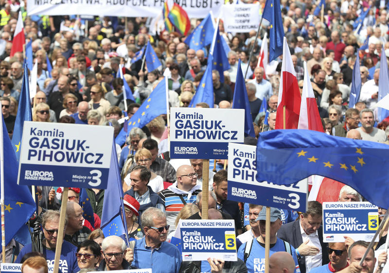 Thousands of Poles with pro-European banners march to celebrate Poland's 15 years in the EU and stressing the nation's attachment to the 28-member bloc ahead of May 26 key elections to the European Parliament, in Warsaw, Poland, Saturday, May 18, 2019. (AP Photo/Czarek Sokolowski)