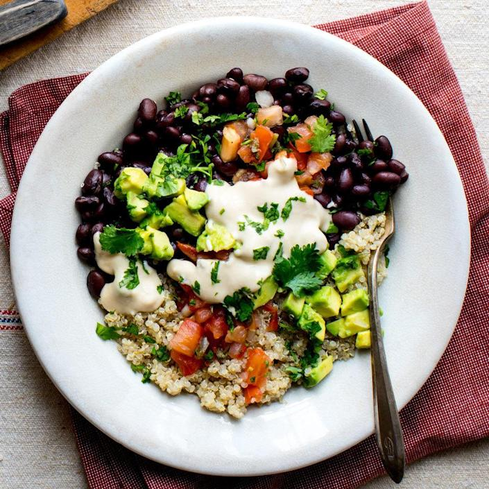 <p>This black bean and quinoa bowl has many of the usual hallmarks of a taco salad, minus the fried bowl. We've loaded it up with pico de gallo, fresh cilantro and avocado plus an easy hummus dressing to drizzle on top.</p>
