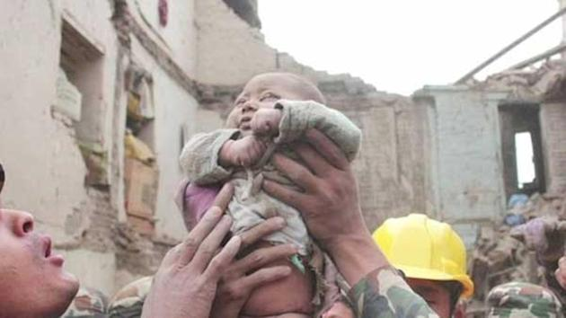Soldiers rescued a 4-month-old boy from rubble left by the devastating earthquake in Nepal.